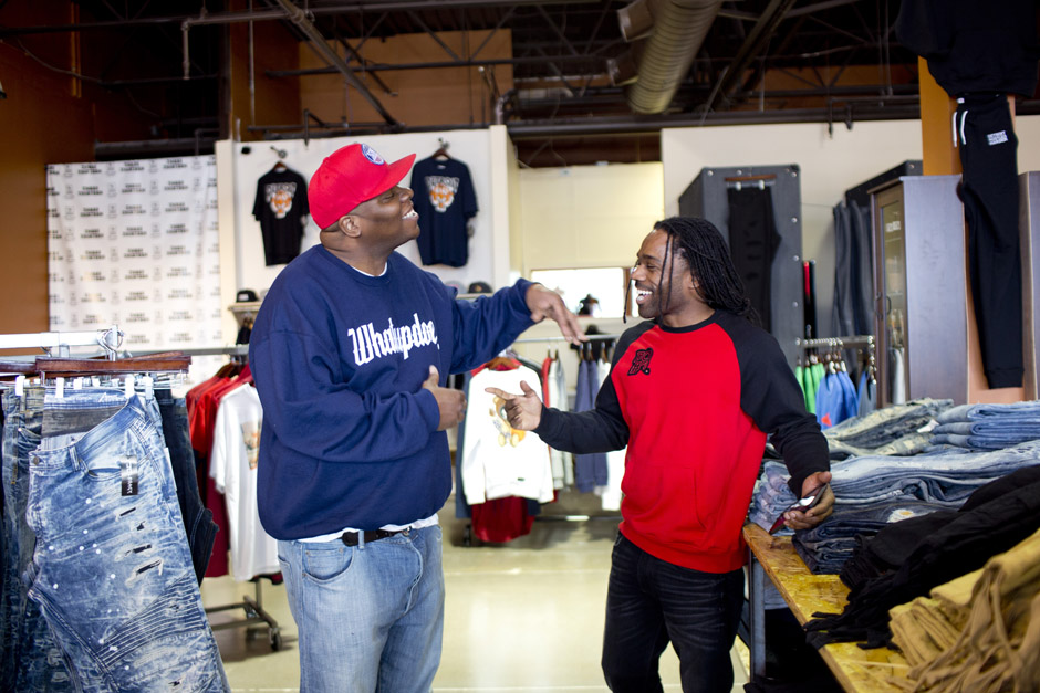 Clement Brown Jr, owner of the boutique Three Thirteen greets Filthy Rockwell, a music producer and entrepreneur.